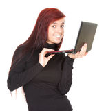 Young woman working on laptop. White background Stock Photos