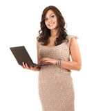 Young woman working on laptop. White background Stock Photo