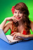 Young woman working on a laptop Stock Image