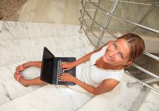 Young woman working on a laptop Royalty Free Stock Photography