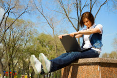 Young woman using laptop in a park Royalty Free Stock Image