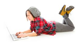 Young woman working on a laptop. Young adult caucasian woman isolated on a white background Stock Photography
