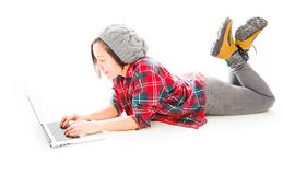 Young woman working on a laptop. Young adult caucasian woman isolated on a white background Royalty Free Stock Images