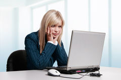Young woman working with laptop. Beautiful young woman working with laptop Royalty Free Stock Images