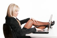 Young woman working with laptop. Beautiful young woman working with laptop Stock Images