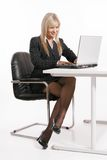 Young woman working with laptop. Beautiful young woman working with laptop Stock Photography