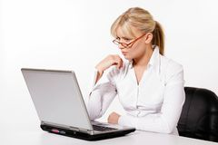 Young woman working with laptop. Beautiful young woman working with laptop Stock Photos