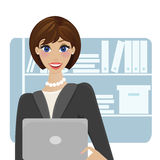 Young Woman Working On Laptop. Beautiful young woman working on laptop in her office Royalty Free Stock Photos