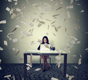 Young woman working on a laptop building online business making money Royalty Free Stock Photography