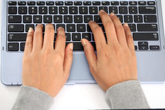 Young woman working on laptop Stock Photos