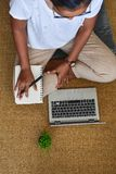 A young woman working on a laptop computer at home. Business con. Cept royalty free stock images