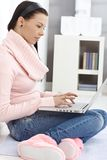Young woman working on laptop at home Stock Photography