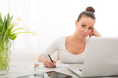 Young woman working with a Laptop Royalty Free Stock Image