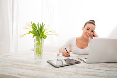 Young woman working with a Laptop Royalty Free Stock Photo