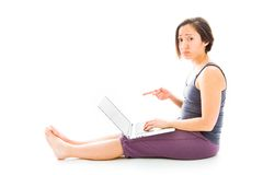 Young woman working on a laptop and looking sadness. Young adult caucasian woman isolated on a white background Stock Photography