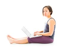 Young woman working on a laptop and looking sadness. Young adult caucasian woman isolated on a white background Royalty Free Stock Images