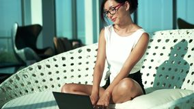 Young woman working with laptop, lounge room stock video
