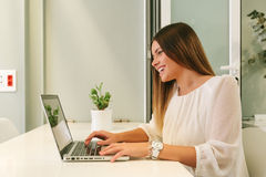 Young Woman Working with a Laptop Royalty Free Stock Photography