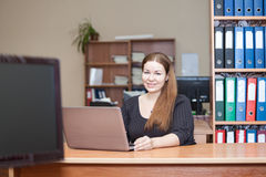 Young woman working with laptop in office Royalty Free Stock Photo