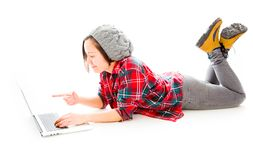 Young woman working on a laptop and pointing. Young adult caucasian woman isolated on a white background Stock Images