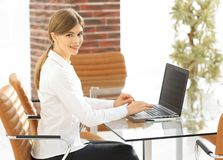 Portrait of young woman working with a laptop . Stock Photos