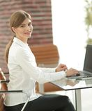 Portrait of young woman working with a laptop . Young woman working with a laptop .young professional Royalty Free Stock Images