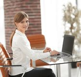 Portrait of young woman working with a laptop . Young woman working with a laptop .young professional Royalty Free Stock Image