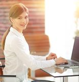 Portrait of young woman working with a laptop . Young woman working with a laptop .young professional Royalty Free Stock Photos