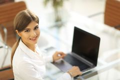 Portrait of young woman working with a laptop . Royalty Free Stock Images