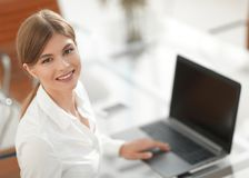 Portrait of young woman working with a laptop . Stock Image