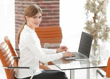 Portrait of young woman working with a laptop . Royalty Free Stock Image