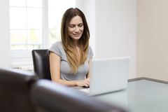 Young woman working on laptop Royalty Free Stock Images