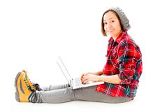 Young woman working on a laptop with smiling Royalty Free Stock Photos