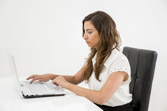 Young woman working on a Laptop Stock Images