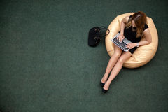 Young woman working on laptop, top view royalty free stock images