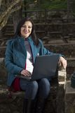 Young woman working on a laptop Royalty Free Stock Photo