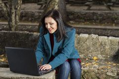 Young woman working on a laptop Royalty Free Stock Image