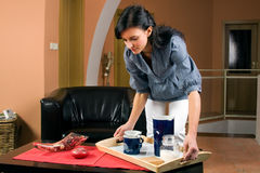 Young woman working in living-room Royalty Free Stock Photography