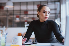 Young woman working new business assignment stock photo