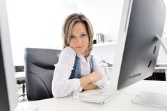 Young woman working at the office. Beautiful young woman working at the office Royalty Free Stock Images