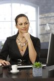 Young woman working at office Royalty Free Stock Photos