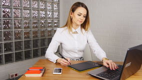 Young woman working in office with graphic tablet stock footage