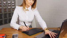 Young woman working in office with graphic tablet stock video footage