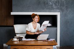 Young woman working in the office Stock Images