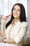 Young woman working in office Stock Image