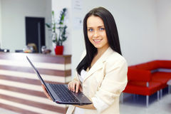 Young woman working in office Royalty Free Stock Photography