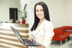 Young woman working in office Royalty Free Stock Photos