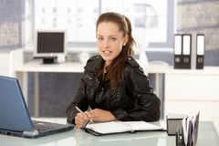 Young woman working in office smiling Stock Image