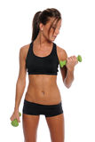 Young Woman Working Out. Beautiful young woman working out with dumbbells isolated over white background Stock Photos