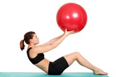 Young woman working out with ball Stock Photo